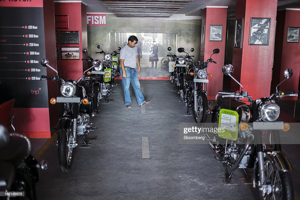A customer inspects an Eicher Motors Ltd Royal Enfield motorcycle on display at the company`s Royal Enfield flagship dealership in Gurgaon India on...