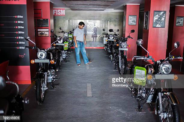 Customer inspects an Eicher Motors Ltd. Royal Enfield motorcycle on display at the company's Royal Enfield flagship dealership in Gurgaon, India, on...