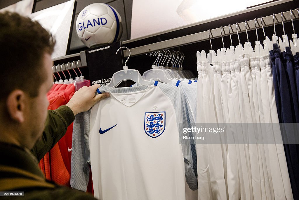 new styles 2fae5 30843 A customer inspects an official England national football ...