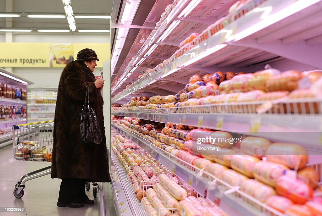 A customer inspects packets of processed meat displayed in a chilled cabinet inside a Lenta LLC supermarket in Prokopyevsk, Kemerevo region, Russia, on Wednesday, March 6, 2013. Lenta LLC, a Russian hypermarket operator controlled by TPG Capital, is selling its first bond to expand after using company funds for a leveraged buyout by the U.S. firm. Photographer: Andrey Rudakov/Bloomberg via Getty Images
