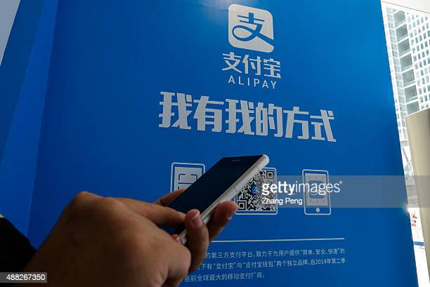 A customer is downloading Alipay app on the smartphone Alipay is China's leading online thirdparty payment service provider under ecommerce giant...
