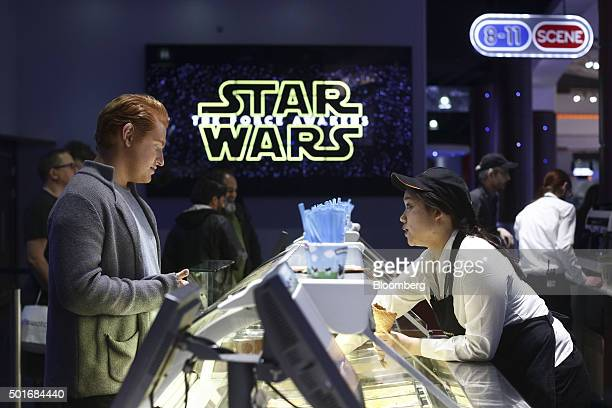A customer is served ice cream at the first public screening of Walt Disney Co's Star Wars The Force Awakens at a Vue Entertainment Ltd cinema in...