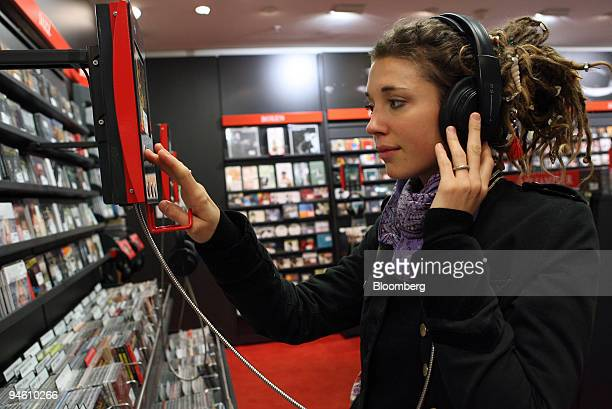 Customer Julia Wunderlich shops for CDs in a Dussmann shop in Berlin Germany Wednesday October 25 2006 Business confidence in Germany and France...