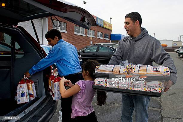 Customer Kamal Moharam right gets help from his daughter Nadine center and son Kareem loading their car with Hostess Brands Inc Wonder Bread at the...