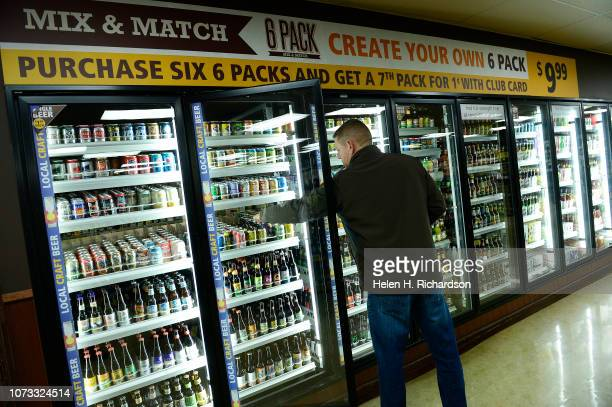 Customer Keith Snyder takes advantage of the pick 6 to create your own six pack of locally brewed and crafted Colorado beer at Safeway on December 13...