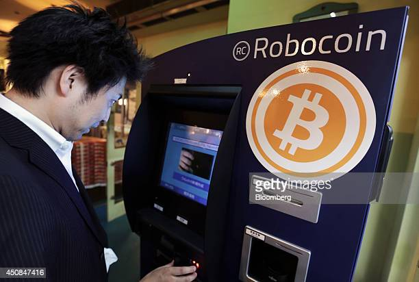 Customer Kiyono Yuichi purchases bitcoins from the BMEX bitcoin exchange's Robocoinbranded automated teller machine at The Pink Cow restaurant and...