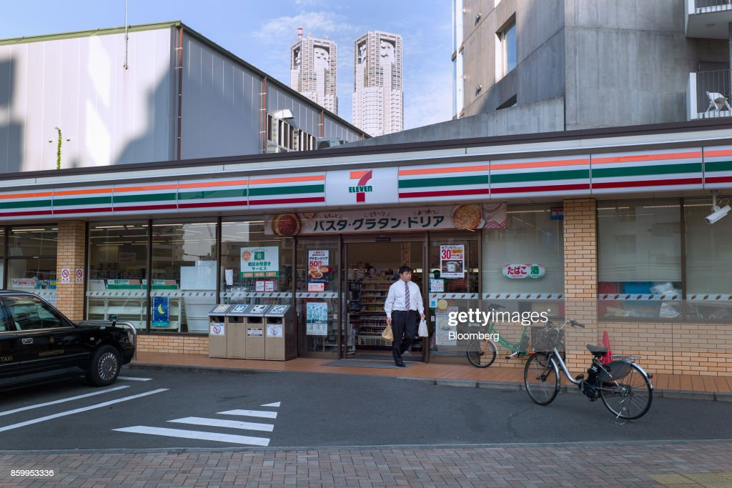 A customer leaves a 7-Eleven convenience store, operated by Seven & i Holdings Co., in Tokyo, Japan, on Sunday, Oct. 9, 2017. Seven & i is scheduled to report its second-quarter earnings results on Oct. 12. Photographer: Kentaro Takahashi/Bloomberg via Getty Images