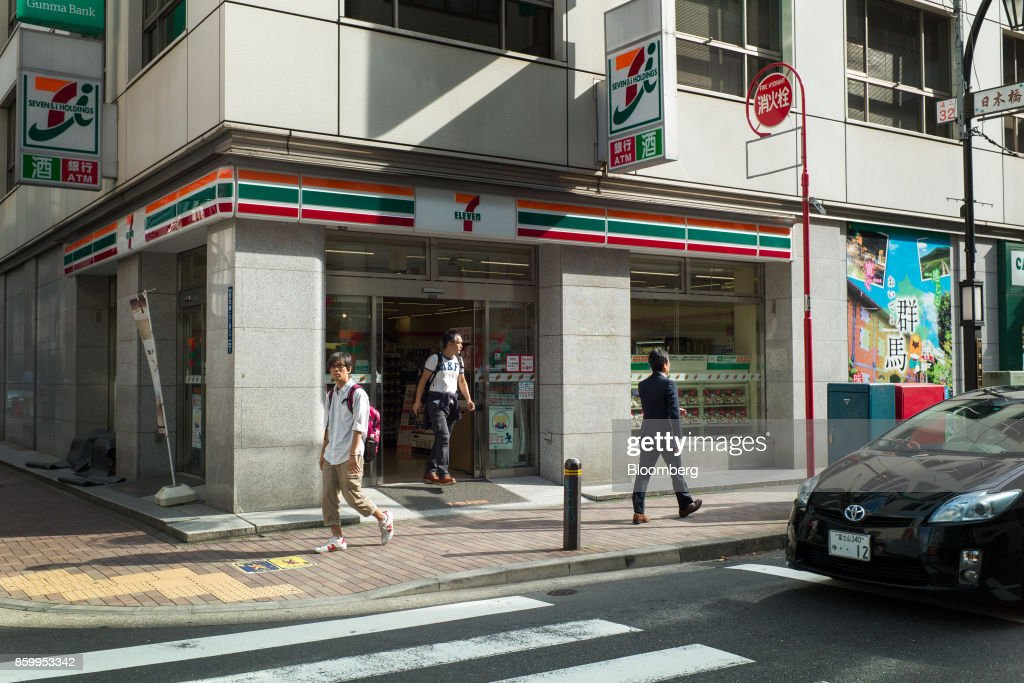 A customer leaves a 7-Eleven convenience store, operated by Seven & i Holdings Co., in Tokyo, Japan, on Sunday, Oct. 8, 2017. Seven & i is scheduled to report its second-quarter earnings results on Oct. 12. Photographer: Kentaro Takahashi/Bloomberg via Getty Images