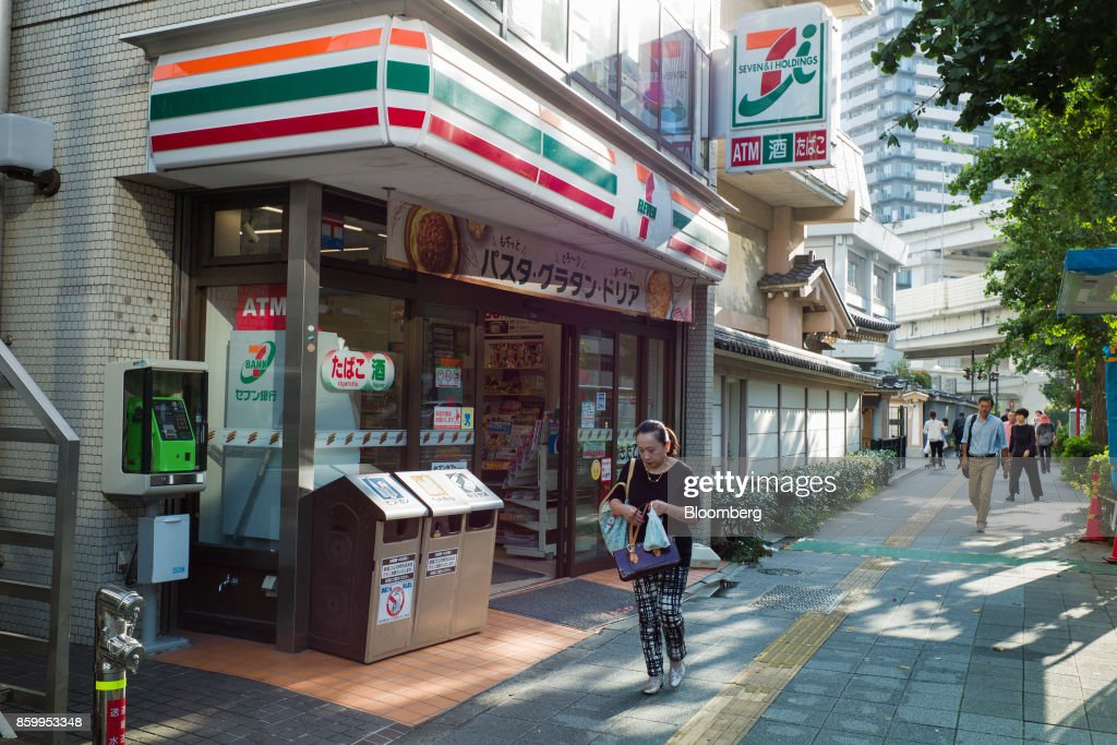 A customer leaves a 7-Eleven convenience store, operated by Seven & i Holdings Co., in Tokyo, Japan, on Sunday, Oct. 10, 2017. Seven & i is scheduled to report its second-quarter earnings results on Oct. 12. Photographer: Kentaro Takahashi/Bloomberg via Getty Images