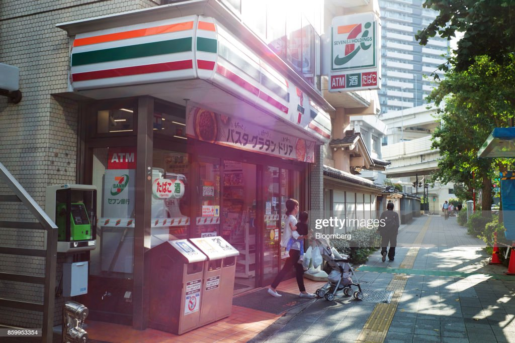 A customer leaves a 7-Eleven convenience store, operated by Seven & i Holdings Co., in Tokyo, Japan, on Monday, Oct. 9, 2017. Seven & i is scheduled to report its second-quarter earnings results on Oct. 12. Photographer: Kentaro Takahashi/Bloomberg via Getty Images