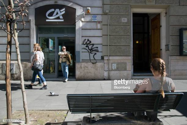 Customer leaves a branch of Credit Agricole SA's Cariparma bank in Rome, Italy, on Tuesday, May 2, 2017. Cariparma is in preliminary talks with the...