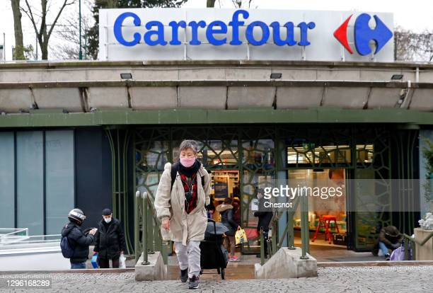 "Customer leaves a Carrefour supermarket on January 13, 2021 in Paris, France. French retailer Carrefour today confirmed ""very preliminary""..."