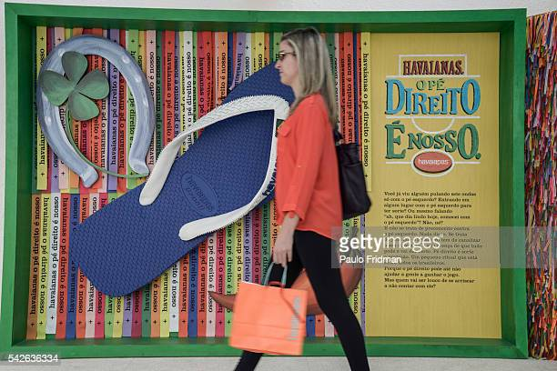 A customer leaves a Havaianas' shop with its purchase Sao Paulo Brazil June 7th 2014