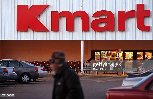 A customer leaves a Kmart store November 29 2007 in Chicago Illinois Sears Holding Corp which owns Kmart reported a 99 percent drop in third quarter...
