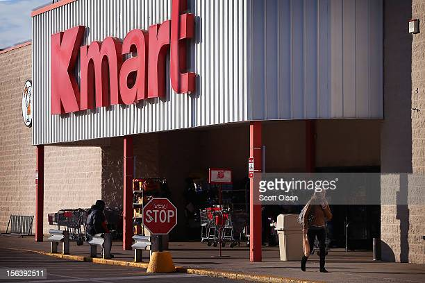 A customer leaves a Kmart store on November 14 2012 in Chicago Illinois Sears Holdings which owns Kmart will report 3rd quarter earnings tomorrow...