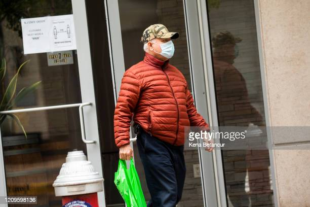 A customer leaves a liquor store while wearing a face mask on April 10 2020 in Jersey City New Jersey On Wednesday New Jersey Governor Phil Murphy...