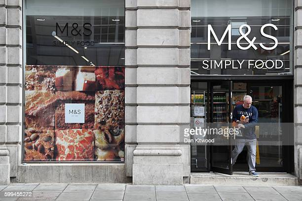 A customer leaves a Marks and Spencer food store on September 5 2016 in London England The retail chain Marks and Spencer is planning to cut around...