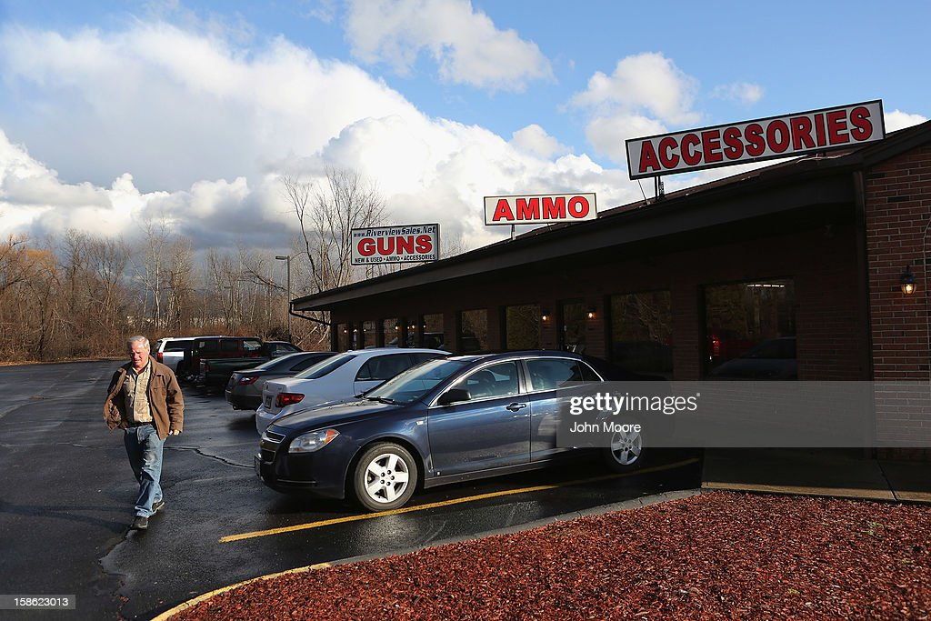 A customer leaves after seeing a closed sign on the front door of the Riverview Gun Sales shop on December 21, 2012 in East Windsor, Connecticut. According to the Hartford Courant, sources investigating the massacre at the Sandy Hook Elementary School in Newtown have said the Bushmaster rifle used by the gunman Adam Lanza was legally purchased at the shop by his mother Nancy Lanza. The Courant also reports that records show the guns used in a previous mass shooting in Connecticut in 2010, where Omar Thornton killed eight people and himself at Hartford Distributers Inc, were also purchased at Riverview Gun Sales. On Thursday agents from the federal Bureau of Alcohol, Tobacco, Firearms and Explosives (ATF), and local police raided and closed the gun shop.