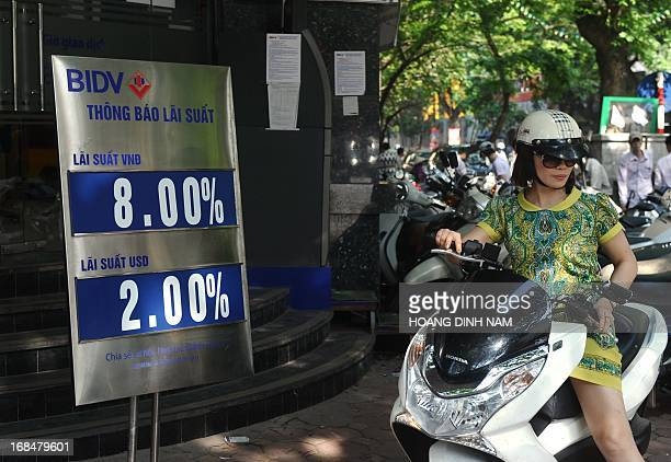 Customer leaves an outlet of the local commercial Bank for Investment and Development of Vietnam with saving interest rates offered for the local...