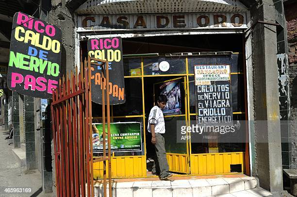 A customer leaves Casa de Oro restaurant a place specializing in Cardan a soup made with bull penis and testicles at a restaurant in La Paz on...