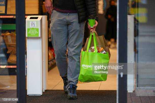 Customer leaves the Amazon.com Inc. Amazon Fresh cashierless convenience store in the Ealing area of London, U.K., on Thursday, March 4, 2021. The...