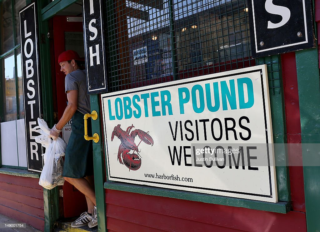 A customer leaves the Harbor Fish Market on July 21, 2012 in Portland, Maine. A mild winter and warmer than usual spring caused lobsters to shed their shells six weeks earlier than usual which resulted in an overabundance of lobsters in the Northeastern United States that has driven down prices to record lows. Lobstermen hope to make at least $4.00 a pound to turn a profit but prices this year have been as low as $1.25 a pound.