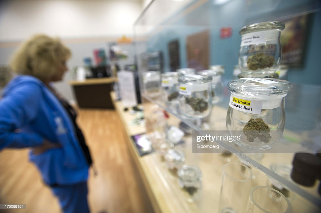 A customer, left, looks at items for sale at the ARC Healing Center medical-marijuana dispensary in San Jose, California, U.S., on Thursday, Feb. 7, 2013. San Jose is the medical-marijuana capital of Silicon Valley with 106 clinics, about twice as many per square mile as Los Angeles. Photographer: David Paul Morris/Bloomberg via Getty Images