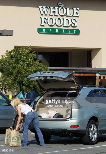 A customer loads bags of groceries into her car at a Whole Foods store February 17 2010 in San Rafael California Whole Foods Market reported a 79...
