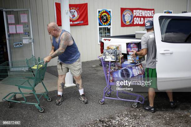 A customer loads boxes of fireworks into a vehicle outside a store in Catlettsburg Kentucky US on Thursday June 28 2018 According to the American...