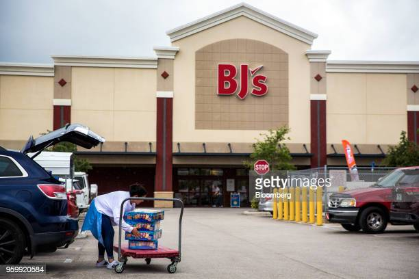 A customer loads groceries into the trunk of a vehicle outside a BJ's Wholesale Club Holdings Inc location in Miami Florida US on Thursday May 17...