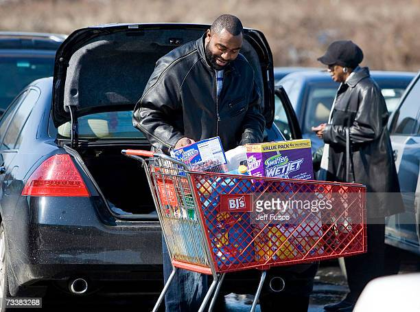 A customer loads his car after shopping at BJ's Wholesale Club February 21 2007 in Philadelphia Pennsylvania Yesterday the giant wholesaler announced...