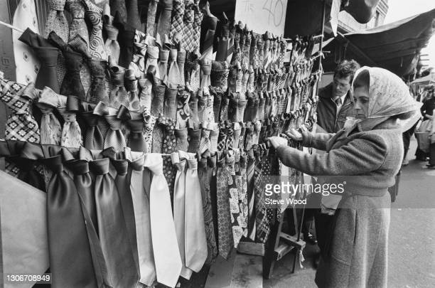 Customer looking at a large array of ties at Petticoat Lane Market in East London, 1st April 1973.