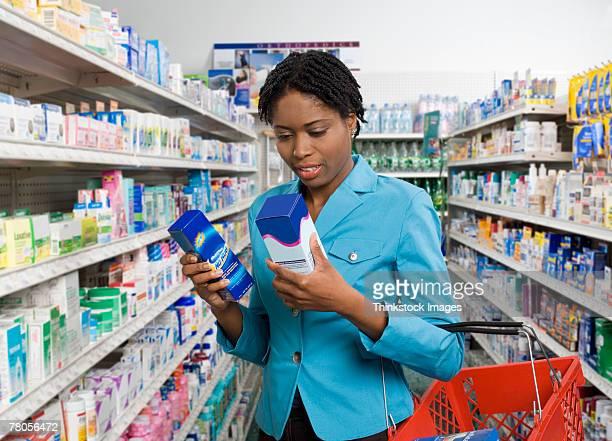 Customer looking at medication boxes