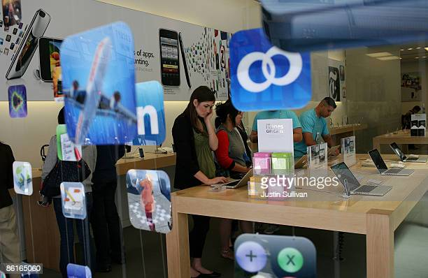 A customer looks a display of MacBook Pro laptops at an Apple store April 22 2009 in San Francisco California California Apple announced quarterly...