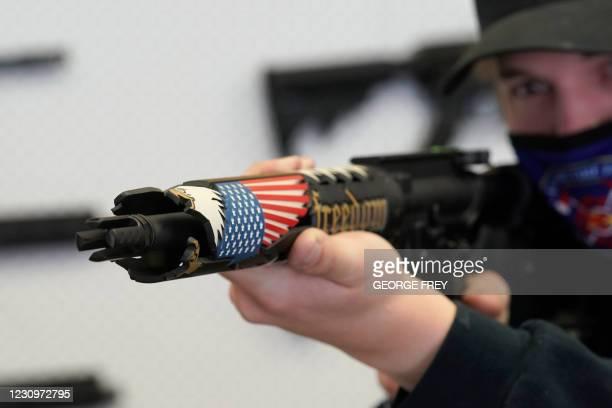 Customer looks at a custom made AR-15 style rifle at Davidson Defense in Orem, Utah on February 4, 2021. - Gun merchants sold more than 2 million...