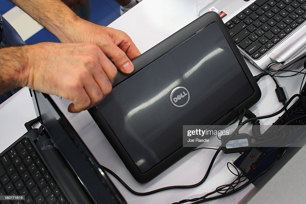 A customer looks at a Dell computer on display at the Electric Avenue store on February 5, 2013 in Miami, Florida. Dell Inc. today announced it will be taken private in a deal valued at about $24.4 billion. The company will be acquired by Dell founder and Chief Executive Michael S. Dell and global technology investment firm Silver Lake and Microsoft Corp. will invest $2 billion in the deal.