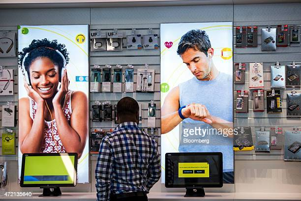 Customer looks at a display at a Sprint Corp. Store in Palo Alto, California, U.S., on Friday, May 1, 2015. Sprint Corp. Is scheduled to release...