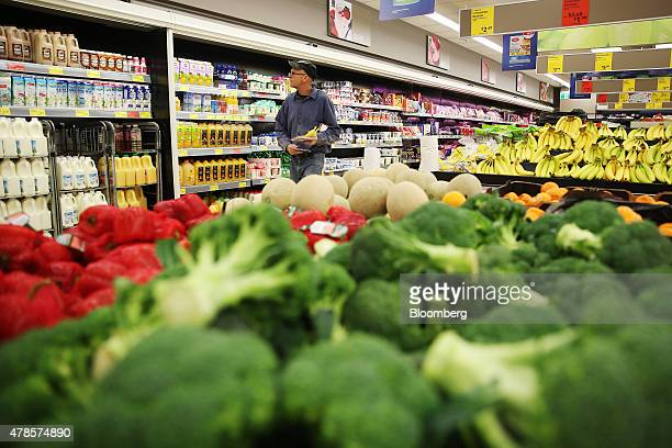 A customer looks at a display of orange juices at an Aldi Stores Ltd food store in Sydney Australia on Thursday June 25 2015 Australia's biggest...