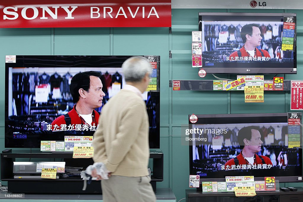 A customer looks at a Sony Corp. Bravia television, left, and LG Electronics Inc. televisions displayed at the Labi Ofuna electronics store, operated by Yamada Denki Co., in Yokohama City, Kanagawa Prefecture, Japan, on Friday, April 27, 2012. Consumer prices excluding fresh food rose 0.2 percent from the year before, exceeding estimates, a government report showed earlier today. Photographer: Kiyoshi Ota/Bloomberg via Getty Images