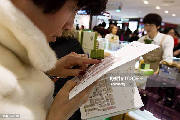 A customer looks at a store map at a Hotel Lotte Co Duty Free store in Seoul South Korea on Thursday Feb 4 2016 Hotel Lotte the lodgings and dutyfree...