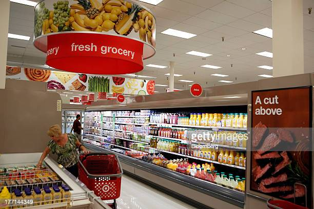 A customer looks at frozen food items for sale in the grocery section inside a Target Corp store in Torrance California US on Tuesday August 20 2013...
