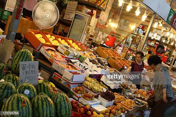 Customer looks at fruit at Noeun Agricultural and Marine Products Wholesale Market in Daejeon, South Korea, on Tuesday, July 16, 2013. South Korea...