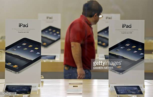 A customer looks at iPads on sale at an apple store in Carugate a suburb of Milan as the iconic tablet computer goes on sale on May 28 2010 Apple's...