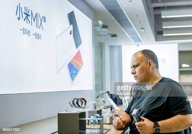 Customer looks at Mi Band smart watches displayed inside of the Xiaomi Corp store on Nathan Road in Hong Kong on May 7 2018 in Hong Kong Hong Kong A...