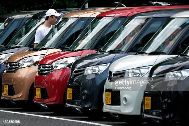 A customer looks at Nissan Motor Co second hand vehicles displayed at a dealership in Yokohama Kanagawa Prefecture Japan on Monday July 28 2014...