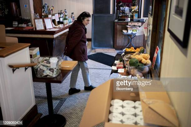 A customer looks at pantry items for sale at Chef Geoff's restaurant in Washington DC US on Thursday March 26 2020 As the wheels of government turn...
