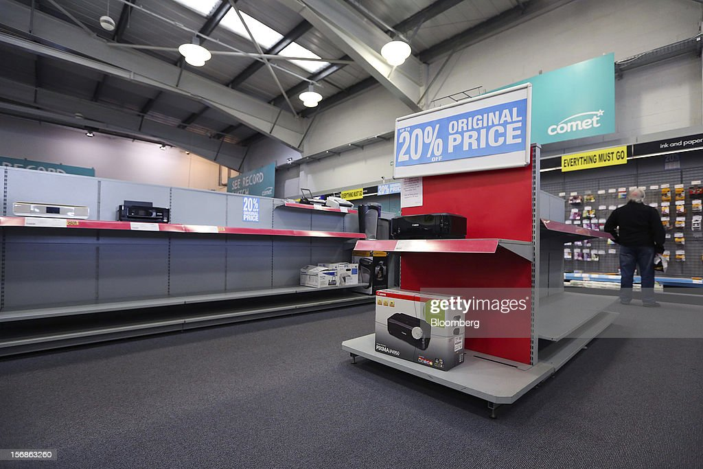 A customer looks at printer inks displayed near empty shelving inside a Comet electronics store in Slough, U.K., on Friday, Nov. 23, 2012. Comet, a U.K. electronics chain, appointed Deloitte LLP as insolvency administrator, less than a year after being bought by private-equity firm OpCapita LLP. Photographer: Chris Ratcliffe/Bloomberg via Getty Images