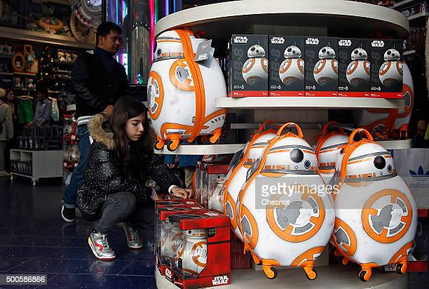 A customer looks at Star Wars BB8 droid toys in the Disney store at Champs Elysee Avenue on December 09 2015 in Paris France Toys from Star Wars...