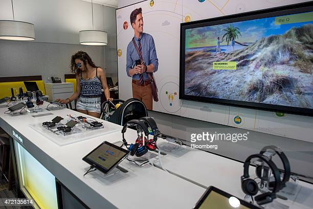 Customer looks at tablets on sale at a Sprint Corp. Store in Palo Alto, California, U.S., on Friday, May 1, 2015. Sprint Corp. Is scheduled to...