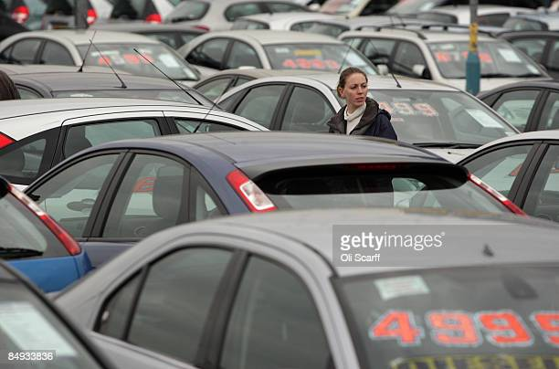 A customer looks at the cars on sale at Cargiant the world's largest car supermarket in White City on February 18 2009 in London The Cargiant site on...